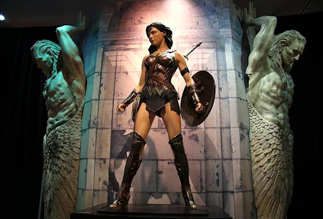 "<p><a href=""https://www.yahoo.com/movies/tagged/wonder-woman"" data-ylk=""slk:Wonder Woman"" class=""link rapid-noclick-resp"">Wonder Woman</a> in full costume stands proud to greet visitors at the opening of her new <a href=""https://www.wbstudiotour.com/dc-universe-exhibit"" rel=""nofollow noopener"" target=""_blank"" data-ylk=""slk:Warner Bros. Studios' exhibit"" class=""link rapid-noclick-resp"">Warner Bros. Studios' exhibit </a>in Burbank. (Photo: Jacob Kramer/Yahoo Movies) </p>"