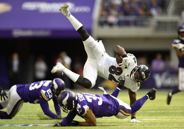 <p>Benjamin Watson #82 of the Baltimore Ravens is upended by Andrew Sendejo #34 of the Minnesota Vikings in the second quarter of the game on October 22, 2017 at U.S. Bank Stadium in Minneapolis, Minnesota. (Photo by Hannah Foslien/Getty Images) </p>