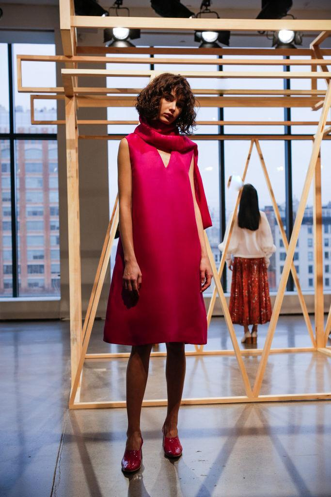 <p>A pink sleeveless dress and scarf at the Claudia Li FW18 show. (Photo: Getty) </p>