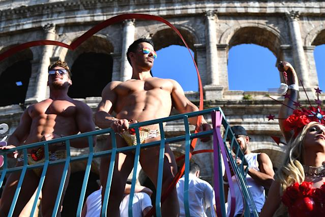 <p>A reveller poses in front of the Coliseum during the Gay Pride Parade in Rome on June 9, 2018. (Photo by Vincenzo Pinto/AFP/Getty Images) </p>