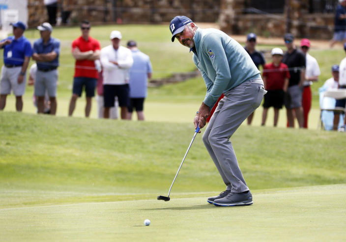 Matt Kuchar reacts as he misses a birdie putt on the 18th green during the second round of the AT&T Byron Nelson golf tournament in McKinney, Texas, Friday, May 14, 2021. (AP Photo/Ray Carlin)