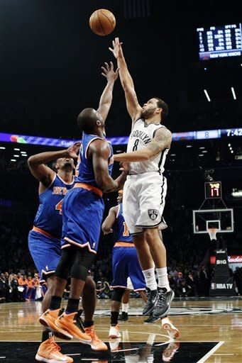 Brooklyn Nets guard Deron Williams (8) shoots over New York Knicks guard Raymond Felton (2) in the first half of their NBA basketball game at Barclays Center, Monday, Nov. 26, 2012, in New York. (AP Photo/Kathy Willens)