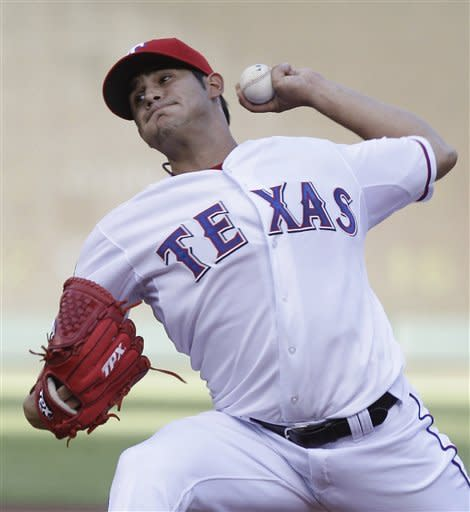 Texas Rangers starting pitcher Martin Perez throws during the first inning of a baseball game against the Boston Red Sox Tuesday, July 24, 2012, in Arlington, Texas. (AP Photo/LM Otero)