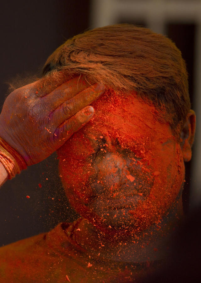 <p>An Indian man smears colored powder on the face of another during Holi celebrations in Hyderabad, India, Thursday, March 1, 2018. (Photo: Mahesh Kumar A./AP) </p>