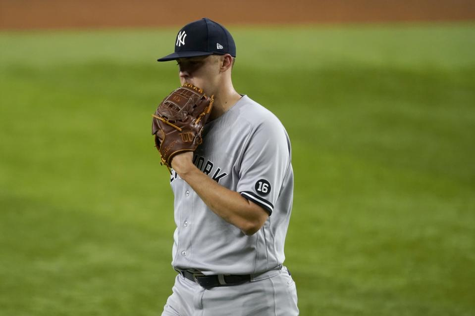 New York Yankees starting pitcher Jameson Taillon walks to the dugout after working against the Texas Rangers in the third inning of a baseball game in Arlington, Texas, Tuesday, May 18, 2021. (AP Photo/Tony Gutierrez)