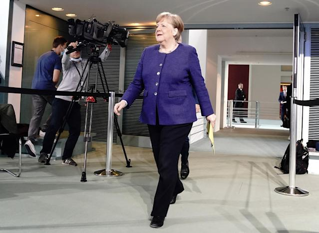 German Chancellor Angela Merkel arrives to address a press conference at the Chancellery in Berlin on April 30, 2020 after a telephone conference with the leaders of the federal states on the restrictions during the COVID-19 pandemic. Photo: Kay Nietfeld /AFP via Getty Images