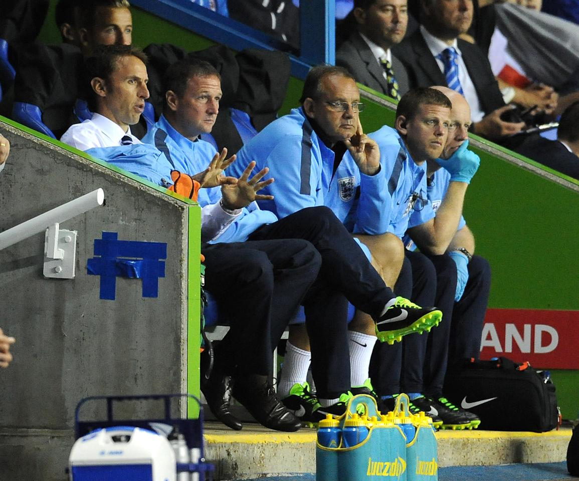 England's Manager Gareth Southgate (left) alongside his assistant, Steve Holland (2nd left) during the UEFA Euro Under 21's Qualifying match at The Madejski Stadium, Reading.
