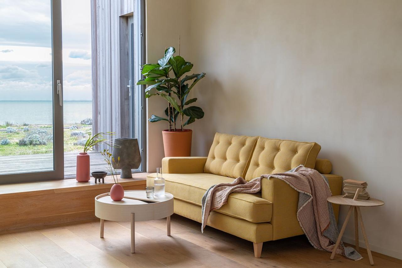 """<p>Not only do we love the colour of this sofa, but it has been woven using 100% recycled fabric. Choose from a variety of colours to find the right one for you. </p><p><a class=""""body-btn-link"""" href=""""https://go.redirectingat.com?id=127X1599956&url=https%3A%2F%2Fwww.heals.com%2Fsofas%2Fmistral-sofa.html&sref=https%3A%2F%2Fwww.housebeautiful.com%2Fuk%2Flifestyle%2Fshopping%2Fg30366588%2Fheals-furniture-sustainable-collection%2F"""" target=""""_blank"""">BUY NOW, FROM £1,799</a></p>"""