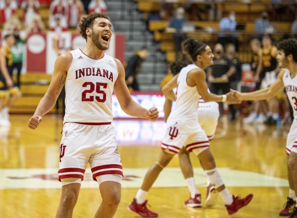 Indiana forward Race Thompson (25) reacts as his team takes a lead during the second half of an NCAA college basketball game against Iowa, Sunday, Feb. 7, 2021, in Bloomington, Ind. (AP Photo/Doug McSchooler)
