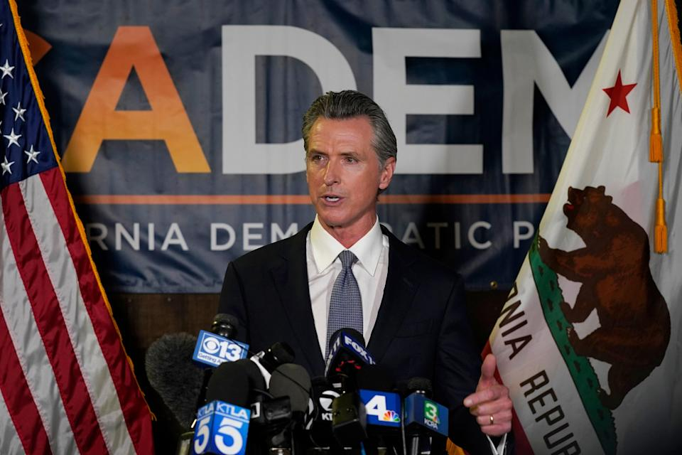 California governor Gavin Newsom addresses reporters after beating back the recall attempt that aimed to remove him from office, at the John L Burton California Democratic Party headquarters in Sacramento, California, on Tuesday (Associated Press)