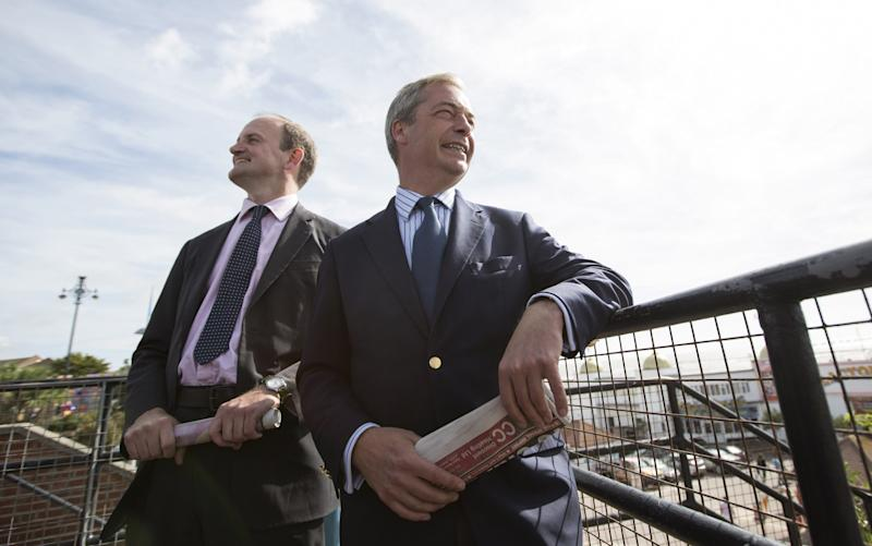 Douglas Carswell's pictured with Nigel Farage - Credit: Oli Scarff /Getty