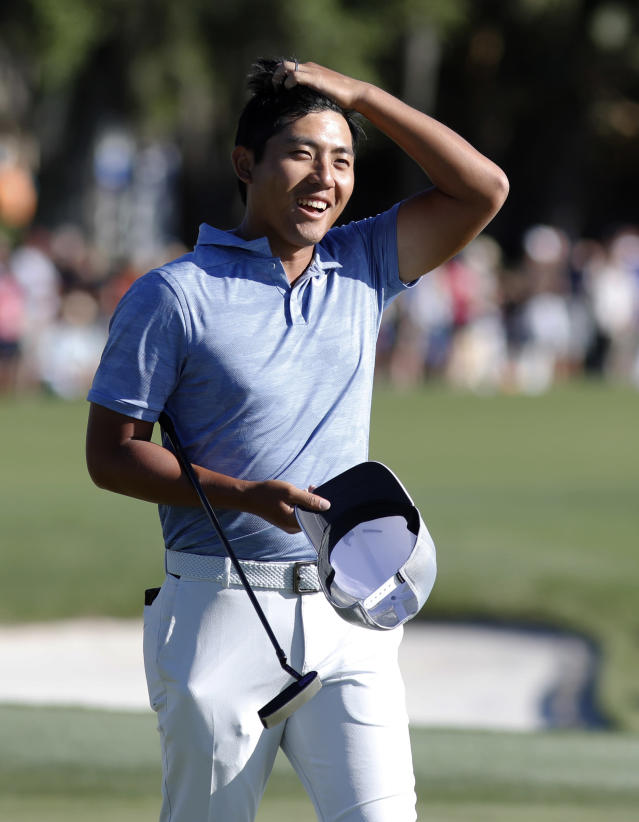 C.T. Pan is all smiles as he walks off the green on 18 during the final round of the RBC Heritage golf tournament at Harbour Town Golf Links on Hilton Head Island, S.C., Sunday, April 21, 2019. Pan won with a 12-under par for his first PGA victory. (AP Photo/Mic Smith)