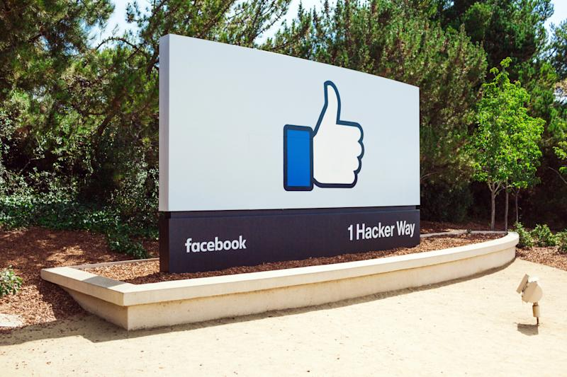 """The Facebook """"like"""" symbol is seen on a billboard at its headquarters."""