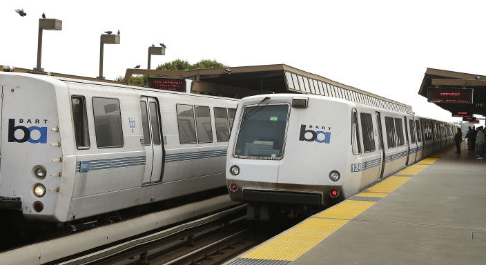 Bay Area Rapid Transit trains wait to board passengers at the Fruitvale station Saturday, Oct. 12, 2013, in Oakland, Calif. A major San Francisco Bay Area transit system ran trains as usual on Saturday after labor negotiations were extended past a midnight deadline, but the threat of a commute-disrupting strike loomed with the unions promising to walk off the job Monday if weekend talks fail to reach a deal. (AP Photo/Ben Margot)