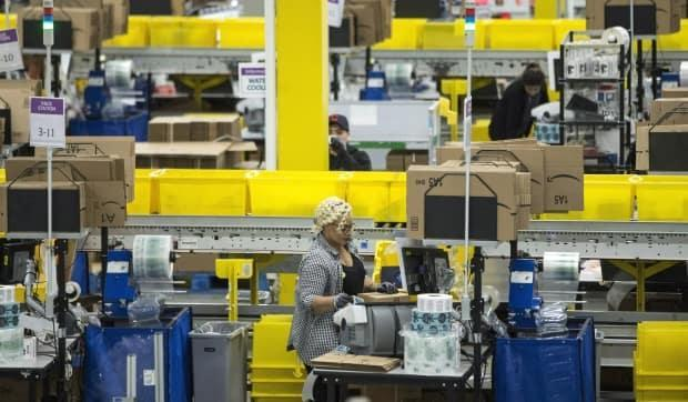 Peel Public Health has partially closed two Amazon fulfilment centres in Brampton, Ont., and Bolton, Ont., to control the spread of COVID-19 outbreaks in those workplaces. (Chris Young/The Canadian Press - image credit)