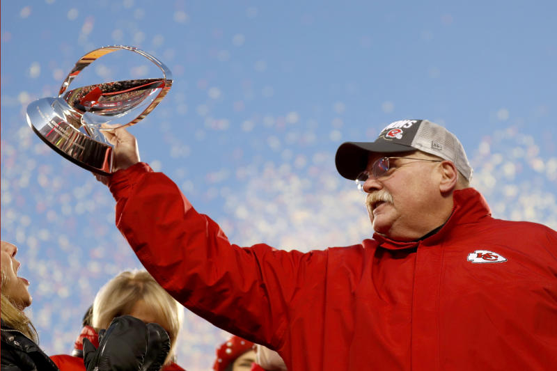Kansas City Chiefs head coach Andy Reid holds the Lamar Hunt Trophy after the NFL AFC Championship football game against the Tennessee Titans Sunday, Jan. 19, 2020, in Kansas City, MO. The Chiefs won 35-24 to advance to Super Bowl 54. (AP Photo/Jeff Roberson)