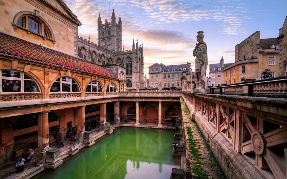 """<p>Famous for its ancient Roman Baths, there's plenty to do in this adorable city for the day. </p><p>A visit to the Thermae Bath Spa (the only natural thermal hot springs in Britain) is a must, as well as a walk around the Royal Crescent, Bath Abbey, Pulteney Bridge, the Holbourne Museum and the incredible range of speakeasy bars located in the vaults underneath the city. </p><p>There are also plenty of spots to dip your toe into open water swimming at the likes of Vobster Quay, Tarr Steps Nature Reserve and Claverton Weir.</p><p><strong>Distance from London</strong>: 114.7 miles</p><p><strong>How to get there</strong>: London Paddington to Bath Spa via <a href=""""https://www.thetrainline.com/book/results?origin=2144c4ddc11461cf9b03af198933e8df&destination=9c4d309954429ce74967cbe88b6359cf&outwardDate=2020-07-16T14%3A30%3A00&outwardDateType=departAfter&journeySearchType=single&passengers%5B%5D=1990-07-16&selectedOutward=Qq1AGm7HFoU%3D%3A8ZILD4tv1vE%3D"""" rel=""""nofollow noopener"""" target=""""_blank"""" data-ylk=""""slk:train"""" class=""""link rapid-noclick-resp"""">train</a> (1hr 21mins)</p>"""