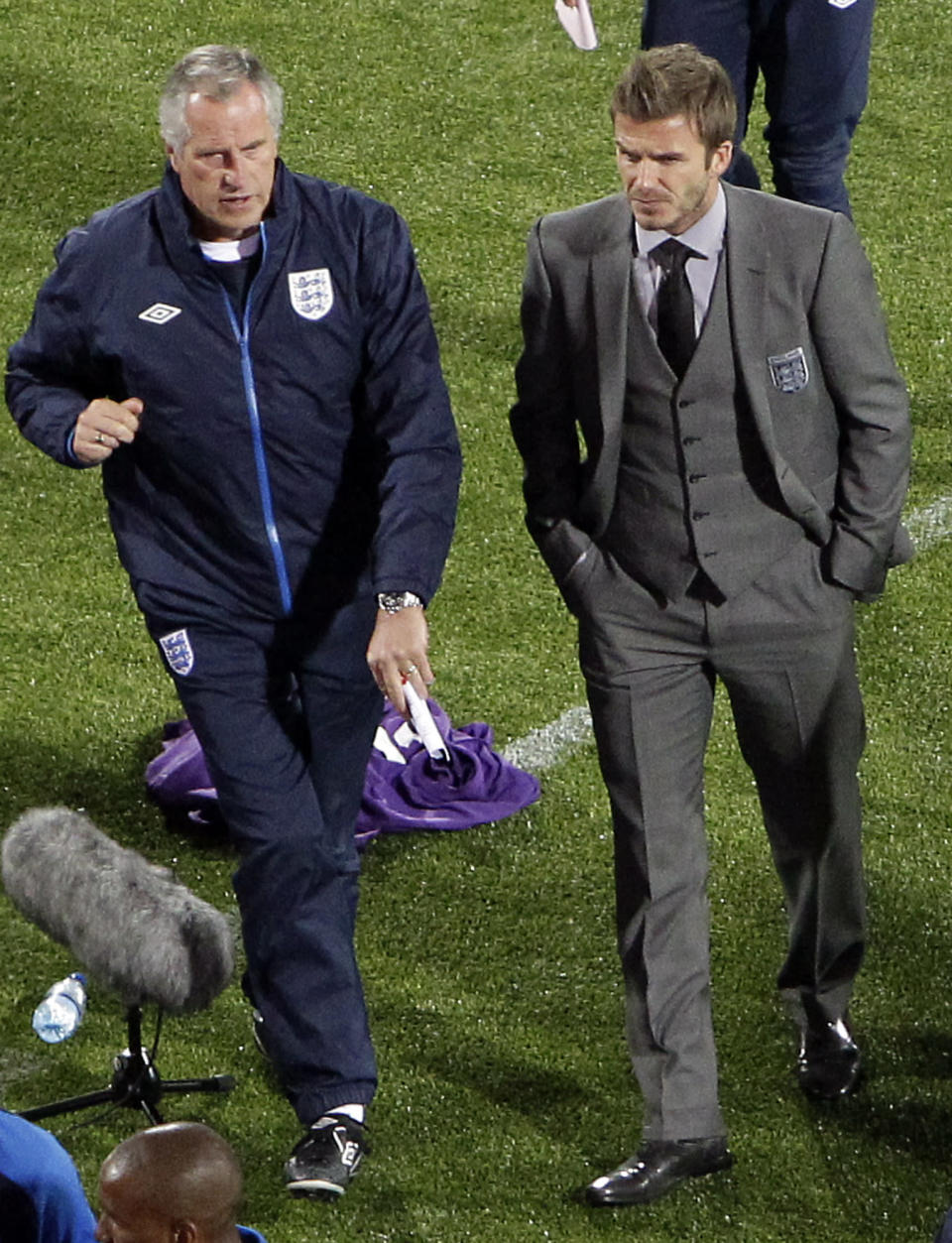 FILE - In this Saturday, June 12, 2010 file photo, England's David Beckham, right, leaves the pitch with goalkeeper coach Ray Clemence after the World Cup group C soccer match between England and the United States at Royal Bafokeng Stadium in Rustenburg, South Africa. Ray Clemence, the former Liverpool, Tottenham and England goalkeeper, has died. He was 72. The Football Association confirmed the news Sunday, Nov. 15, 2020 without giving a cause of death. (AP Photo/Tom Curley, File)