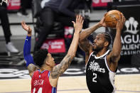 Los Angeles Clippers forward Kawhi Leonard, right, shoots as Philadelphia 76ers forward Danny Green defends during the first half of an NBA basketball game Saturday, March 27, 2021, in Los Angeles. (AP Photo/Mark J. Terrill)