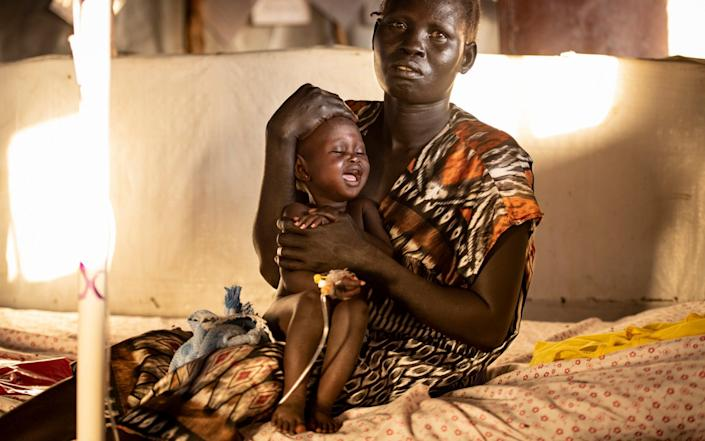 Eight-month-old Achol with her mother. The malnourished infant is being treated for vomiting and diarrhoea - Simon Townsley/The Telegraph