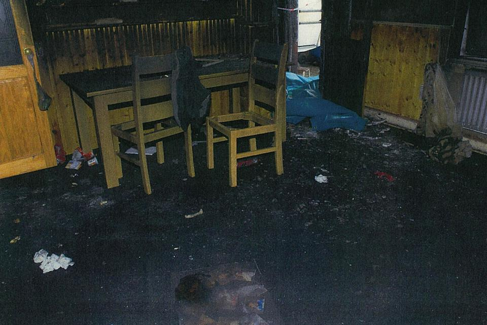 <p>The blackened ruins of the former family home</p>PA