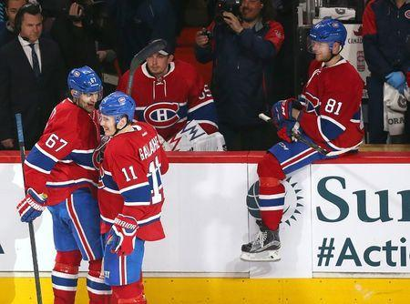 Apr 9, 2016; Montreal, Quebec, CAN; Montreal Canadiens left wing Max Pacioretty (67) celebrates with right wing Brendan Gallagher (11) and center Lars Eller (81) after scoring on an empty net goal against the Tampa Bay Lightning during the third period at Bell Centre. Mandatory Credit: Jean-Yves Ahern-USA TODAY Sports / Reuters Picture Supplied by Action Images