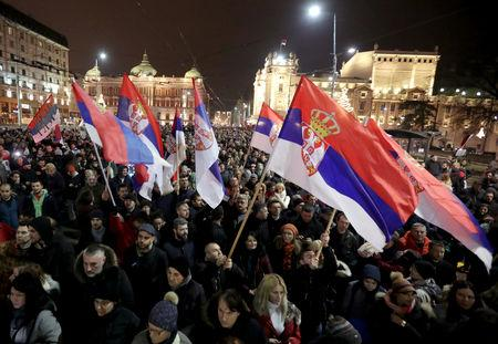 Demonstrators holding Serbian flags attend an anti-government protest in central Belgrade, Serbia, December 29, 2018. REUTERS/Marko Djurica