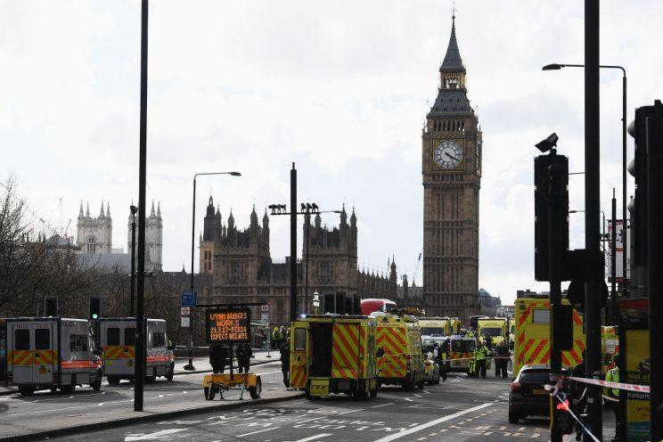 Ambulances, police vehicles and emergency services are seen on Westminster Bridge. (Getty Images)