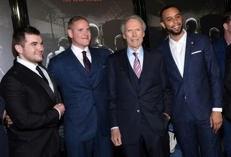 """Train attack heroes Alek Skarlatos, Spencer Stone and Anthony Sadler pose with Clint Eastwood outside the world premiere of """"The 15:17 to Paris"""" in California"""