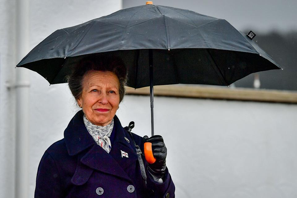 Britain's Princess Anne, Princess Royal, reacts during her visit to the Royal Victoria Yacht Club in Cowes on the Isle of Wight, southern England on April 14, 2021. - The funeral of Britain's Prince Philip, the Duke of Edinburgh, will take place at St George's Chapel, Windsor Castle on Saturday, April 17. (Photo by Ben Birchall / POOL / AFP) (Photo by BEN BIRCHALL/POOL/AFP via Getty Images)