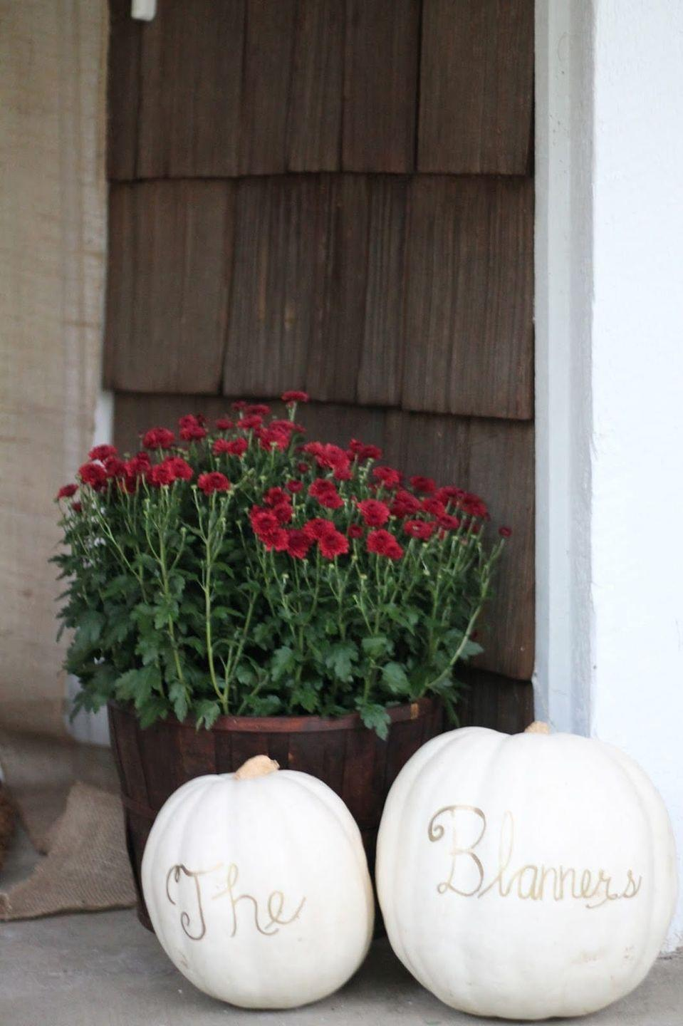 """<p>Personalize a pair of pumpkins with your name, house number, or a simple welcome message. Paint, stencils, or freehand penmanship all work well here.</p><p><strong>Get the tutorial at <a href=""""https://julieblanner.com/fall-porch-decor/"""" rel=""""nofollow noopener"""" target=""""_blank"""" data-ylk=""""slk:Julie Blanner"""" class=""""link rapid-noclick-resp"""">Julie Blanner</a>.</strong></p><p><strong><strong><strong><strong><strong><strong><strong><strong><a class=""""link rapid-noclick-resp"""" href=""""https://go.redirectingat.com?id=74968X1596630&url=https%3A%2F%2Fwww.walmart.com%2Fsearch%2F%3Fquery%3Dfaux%2Bpumpkins&sref=https%3A%2F%2Fwww.thepioneerwoman.com%2Fhome-lifestyle%2Fdecorating-ideas%2Fg36664123%2Fwhite-pumpkin-decor-ideas%2F"""" rel=""""nofollow noopener"""" target=""""_blank"""" data-ylk=""""slk:SHOP FAUX PUMPKINS"""">SHOP FAUX PUMPKINS</a></strong></strong></strong></strong></strong></strong></strong><br></strong></p>"""