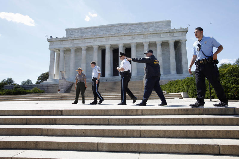 Security keeps people from entering the Lincoln Memorial in Washington, Tuesday, Aug. 23, 2011, after it was evacuated following an earthquake in the Washington area. A 5.9 magnitude earthquake centered in Virginia forced evacuations of all the monuments on the National Mall in Washington and rattled nerves from Georgia to Martha's Vineyard, the Massachusetts island where President Barack Obama is vacationing. No injuries were immediately reported. (AP Photo/Jacquelyn Martin)