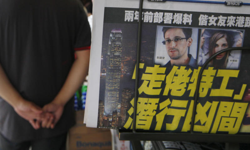 A picture of Edward Snowden, a former CIA employee who leaked top-secret documents about sweeping U.S. surveillance programs, is displayed on the front page of a newspaper in Hong Kong Wednesday, June 12, 2013. The whereabouts of Snowden remained unknown Wednesday, two days after he checked out of a Hong Kong hotel. (AP Photo/Kin Cheung)