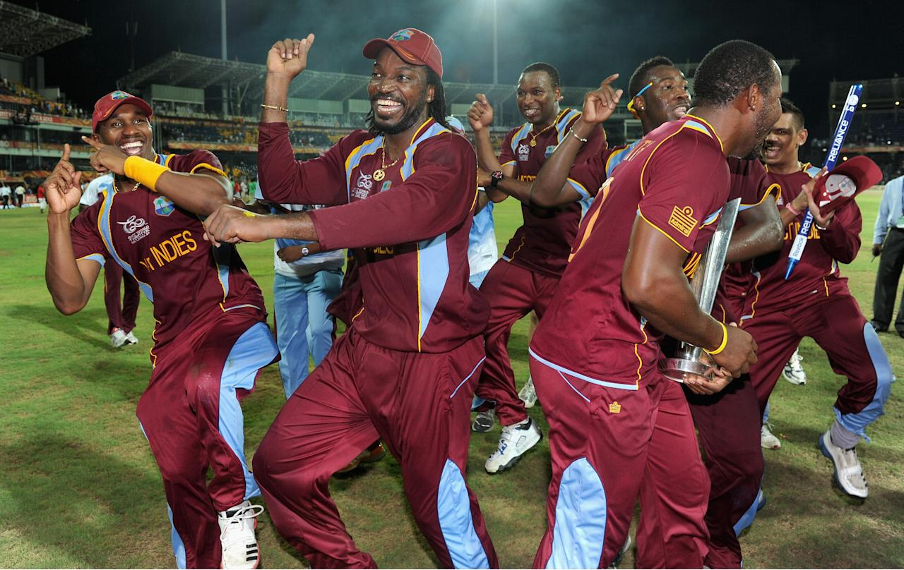COLOMBO, SRI LANKA - OCTOBER 07:  Dwayne Bravo, Chris Gayle and Dwayne Smith of the West Indies celebrate winning the ICC World Twenty20 2012 Final between Sri Lanka and the West Indies at R. Premadasa Stadium on October 7, 2012 in Colombo, Sri Lanka.  (Photo by Gareth Copley/Getty Images)