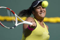Heather Watson, of Britain, returns to Sloane Stephens, of the United States, at the BNP Paribas Open tennis tournament Wednesday, Oct. 6, 2021, in Indian Wells, Calif. (AP Photo/Mark J. Terrill)