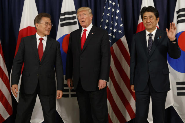 <p>President Donald Trump, center, meets with Japanese Prime Minister Shinzo Abe, right, and South Korean President Moon Jae-in before the Northeast Asia Security dinner at the US Consulate General Hamburg, Thursday, July 6, 2017, in Hamburg, Germany. (Photo: Evan Vucci/AP) </p>