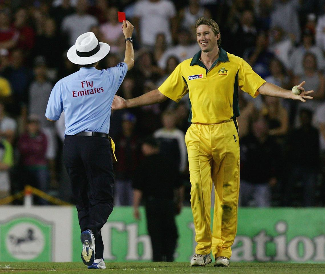 AUCKLAND, NEW ZEALAND - FEBRUARY 17:  Glenn McGrath of Australia is red carded by umpire Billy Bowden after pretending to bowl an underarm delivery for the last ball of the match during the Twenty20 International Match between New Zealand and Australia played at Eden Park on February 17, 2005 in Auckland, New Zealand  (Photo by Hamish Blair/Getty Images)