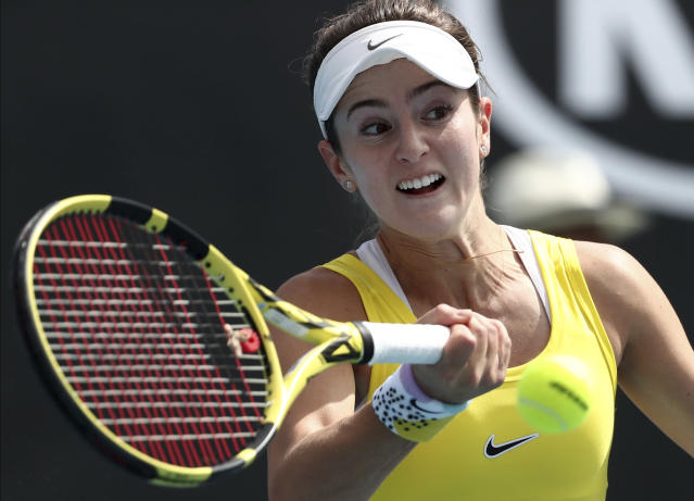 CiCi Bellis of the U.S. makes a forehand return to Karolina Muchova of the Czech Republic during their second round singles match at the Australian Open tennis championship in Melbourne, Australia, Thursday, Jan. 23, 2020. (AP Photo/Dita Alangkara)