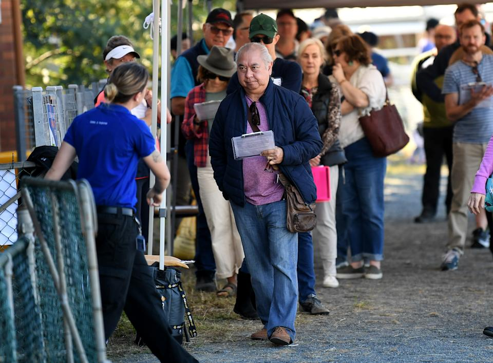 People line up to receive a coronavirus vaccination at the Rocklea Showgrounds in Brisbane. Source: AAP