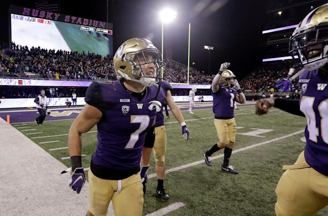 Washington's Taylor Rapp (7) smiles after he intercepted a Stanford pass. (AP Photo)