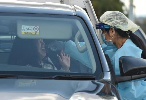 A driver in Sydney gets screened at a pop-up testing centre