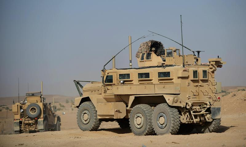 US Marines operate Mine Resistant Ambush Protected (MRAP) vehicles in Afghanistan in June 2012