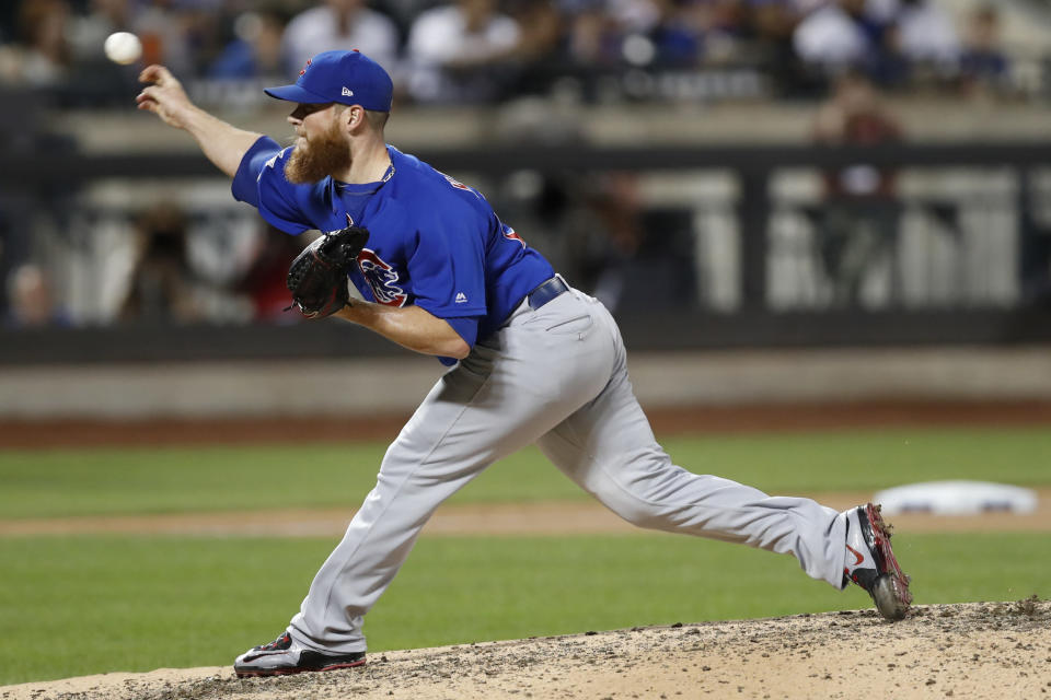 FILE - In this Aug. 29, 2019, file photo, Chicago Cubs' relief pitcher Craig Kimbrel delivers during the ninth inning of a baseball game against the New York Mets in New York. The Cubs have activated closer Kimbrel from the injured list before opening a crucial four-game series against the NL Central-leading St. Louis Cardinals. (AP Photo/Kathy Willens, File)