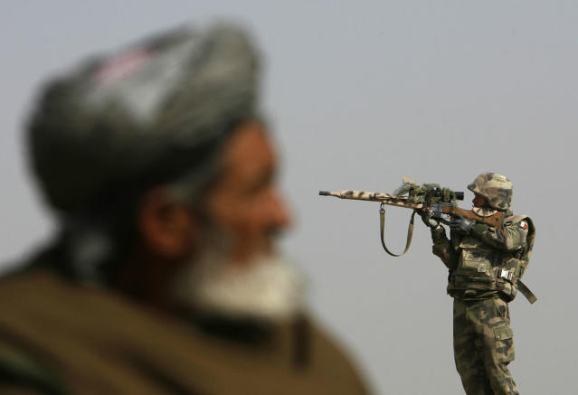 <p>A French sniper (R) looks through his rifle's scope while keeping watch over Qarabagh district, about 40 km (25 miles) north of Kabul, Nov. 20, 2007. (Photo: Ahmad Masood/Reuters) </p>