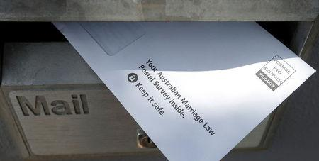 The Australian Bureau of Statistics gay marriage law postal survey form is seen in a residential letterbox in this September 16, 2017 illustration image.        REUTERS/Jason Reed/illustration/Files