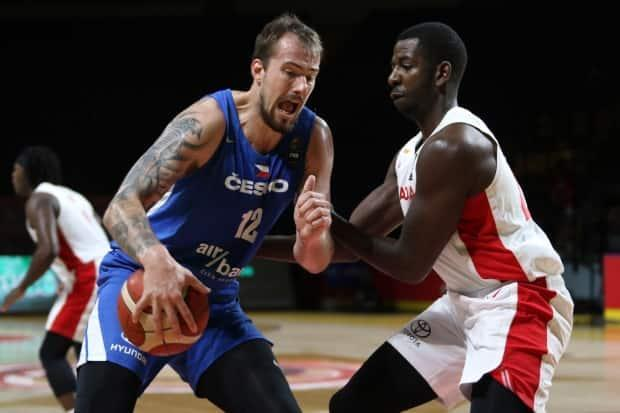 Andrew Nicholson, right, defends against Czech Republic's Ondrej Balvin during Saturday's 103-101 semifinal defeat, at the hands of the Czech Republic, that ended Canada's Olympic dream.  (Chad Hipolito/The Canadian Press - image credit)