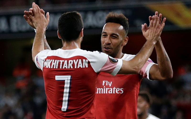 Pierre-Emerick Aubameyang thanks Henrikh Mkhitaryan for setting up his second and Arsenal's third in their 4-2 victory over Vorskla Poltava - Getty Images Europe