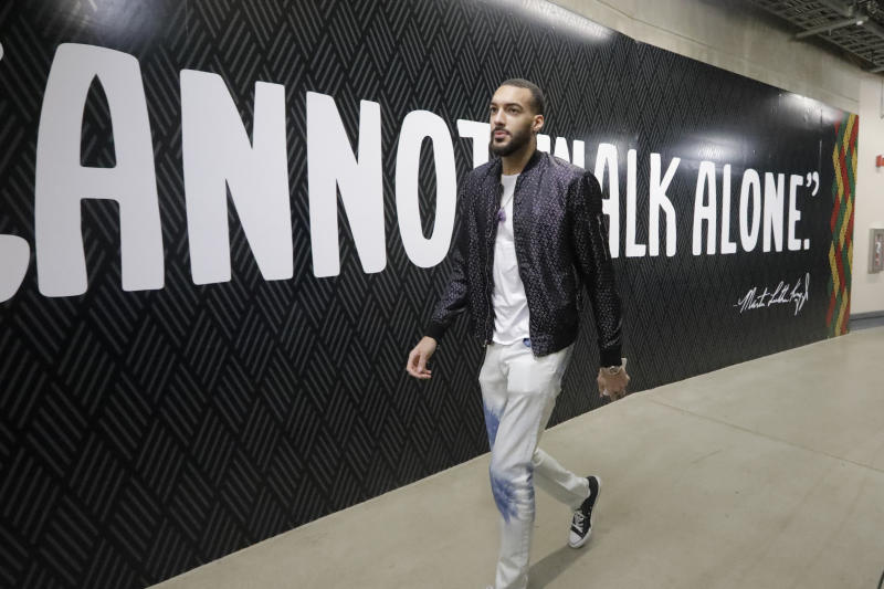 Utah Jazz center Rudy Gobert arrives at the Vivint Smart Home Arena before the start of their NBA basketball game against the Denver Nuggets Wednesday, Feb. 5, 2020, in Salt Lake City. (AP Photo/Rick Bowmer)