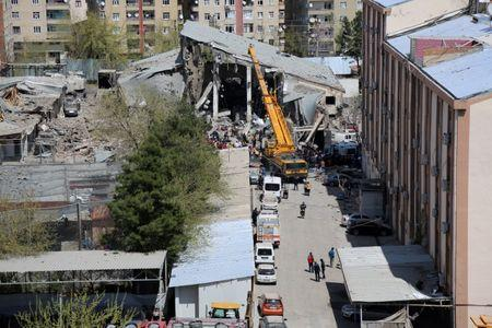 FILE PHOTO :A damaged building is seen after an explosion at a police compound in the southeastern city of  Diyarbakir