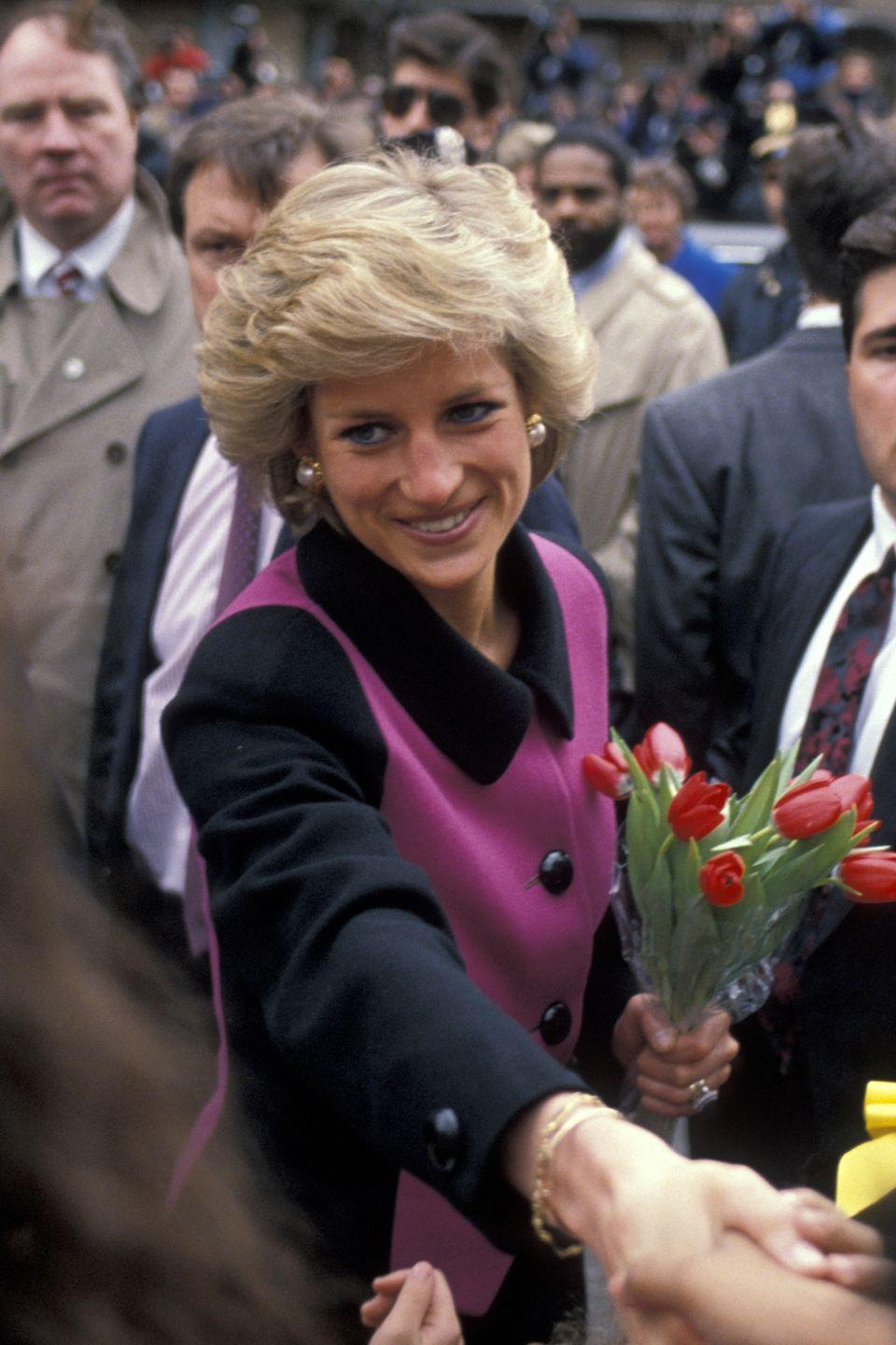 <p>Princess Di greets well-wishers on her way to the Henry Street Settlement, a nonprofit social services agency, in New York's Lower East Side. </p>